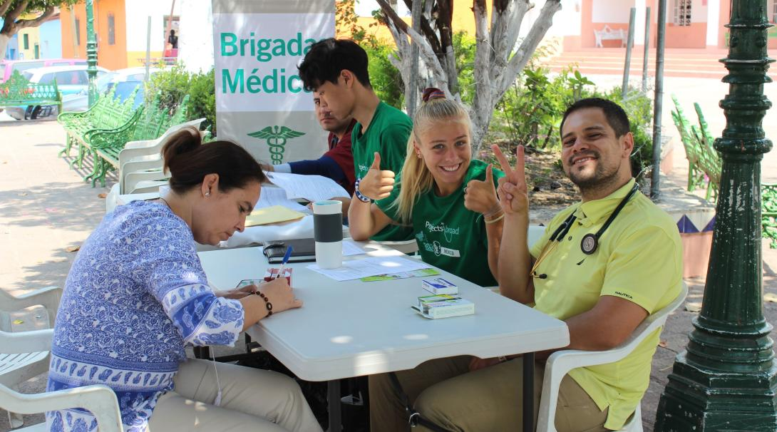 Medical volunteers treat locals at a mobile clinic in Mexico.